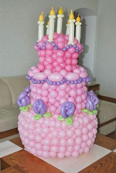 Cake with balloons, my great niece, would freak out if she seen this at her birthday party. .great idea!