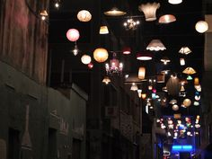 communal lighting installation from donated fixtures by beforelight | monastiraki, athens, greece