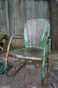 """This is the chair he carried me to and sat me in as it began to snow when we went out for a smoke. He then killed a spider above my head. I looked at him with doe eyes and said: """"No matter what, you're always in """"The Walking Dead.(mode)"""" He replies with THOSE eyes, """"Always """"The Walking Dead"""" darlin always!""""  Needless to say I'll be watching TWD aaallll day!"""