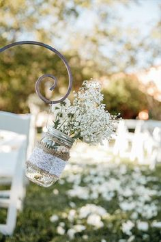 Aisle decor idea with baby's breath and lace