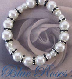 Black and White Bracelet. White Pearl Bracelet. Mother's Day Bracelet. Bridal Bracelet. $6.50, via Etsy.