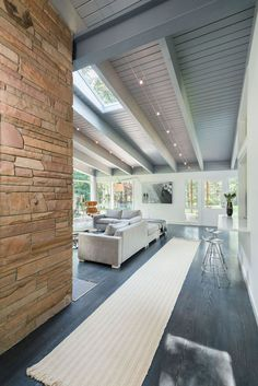 Mid-Century Modern House by Flavin Architects, Lincoln, USA. a way to do lighting in a post and beam!