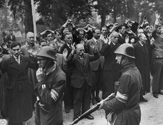 Members of the Dutch resistance guard fellow countrymen accused of collaborating with the Germans during the occupation.