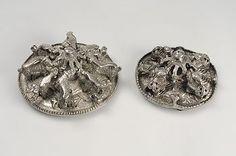 Round silver brooches with animals. Tolsta, Hälsingtuna parish.