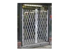 Folding Gate for factory and warehouse door security.  http://www.glassessential.com/security-scissor-folding-gate  #folding #gate #door #foldinggate #expandable #collapsible #security #expandablegate #collapsiblegate #securitygate #storefront #patio #divider #enclosure #storage #access #accesscontrol #windowgate #windowbars