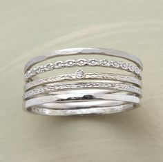 Still looking for wedding band ideas... I want something super thin and I love the idea of stacking bands, but I don't want to take away from my engagement ring. Hmm.