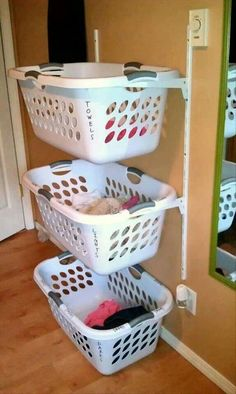 Use shelf brakets to hang laundry baakets. Great for sorting laundry or toys