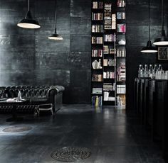 Black warehouse look with leather tufted couch.