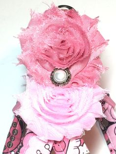 There are dog lovers all over the world and doesnt everyone want their princess to have an up-to-date fashionable look when they take her out for a walk. My shop will bring you just that!!  This listing features my Mod Girl Dog Harness in a pink and mauve floral pattern adorned with two rosettes with a vintage pearl center that lay on each shoulder blade! Your furry friend will be barking for more.  All harnesses are handmade by me from start to finish using high quality designer fabrics and…