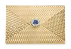 A GOLD, SAPPHIRE AND DIAMOND VANITY CASE, BY CARTIER Of rectangular outline, the guilloché 18k gold case designed as an envelope, centering upon an oval-cut sapphire, weighing approximately 9.12 carats, within a single-cut diamond stylized flower frame resembling a wax seal, the single-cut diamond pushpiece opening to reveal a fitted mirror, two lidded powder compartments, a lipstick holder and a money clip, mounted in 18k gold and platinum, 1951, 5¾ x 3¾ x ¾ ins., with French assay marks…