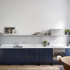 """425 Likes, 31 Comments - Remodelista (@remodelista) on Instagram: """"Poll: What's your favorite element of this moody blue kitchen? A) the marble countertops B) the…"""""""