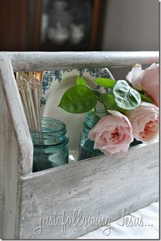old wood tool caddy, vintage French bowl, old silverware and roses in aqua canning jars