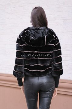 Female Mink Fur with whole skins. Made in Italy. Skins Quality: KOPENHAGEN BURGUNDY; Color: Black – Beige; Closure: With zip; Hood; Lining: 100% Satin; Lining Color: Monocolor; Length: 55 cm;