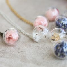 Necklace is made by hand, will have some defects, please pay attention to mind  This necklace is not waterproof, please pay attention to take a shower before remember to take off  Size: 1.6 CM in diameter; Chain length is 45 CM  Not easy to be broken, can be at ease use   Design:  1. pink ch...