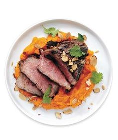 Grilled Lamb With Carrot-Red Pepper Puree recipe: Sprinkle chopped roasted almonds and fresh cilantro leaves over this colorful 30-minute dinner.