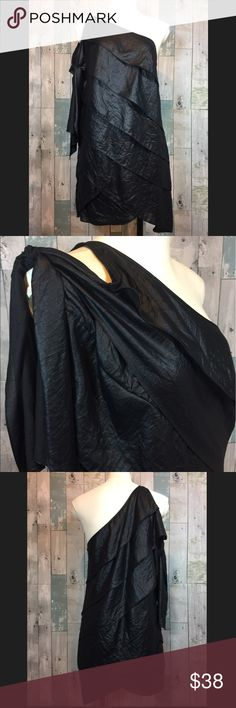 NWOT BCBG MaxAzria black tiered dress Excellent condition!! This dress is a one shoulder dress. (The second photo shows the tie straps on how the dress is actually worn.) 100% polyester. Smoke free and pet free home! BCBGMaxAzria Dresses One Shoulder