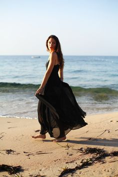 A black maxi dress is a great wardrobe staple for summer - wear it at the beach over a bikini or for evening with heels and jewellery
