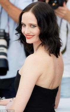 Stunning: Eva Green, 36, cut a chic figure as she stepped out in wide-leg bandeau jumpsuit that she teamed with an incredibly sultry scarlet red lip for the Based On A True Story photocall at Cannes Film Festival on Saturday