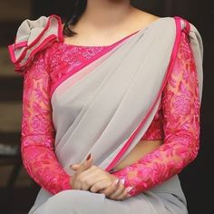 Looking for blouse designs photos? Here are our picks of 30 trending saree blouse models that will blow your mind. Blouse Back Neck Designs, Netted Blouse Designs, Fancy Blouse Designs, Bridal Blouse Designs, Saree Jacket Designs Latest, Dress Designs, Saree Blouse Models, Saree Blouse Patterns, Designer Blouse Patterns