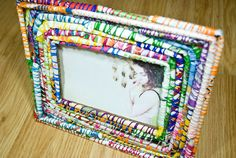 Handmade Magazine Picture Frame. Embroidery thread and rolled magazine pages. Glue too. Cute.