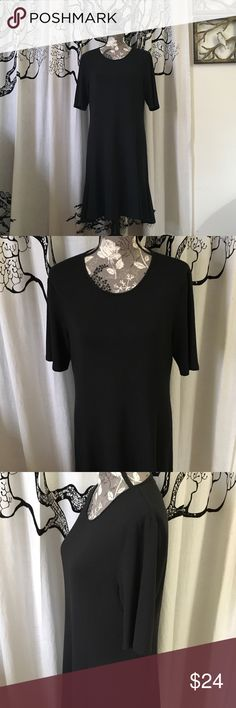 """Tahari Soft A-Line Black Dress SZ XL Super, super soft black dress by Tahari. Short sleeves almost reach the elbow so not too short. Hidden zipper/hook in the back. Panel in the skirt gives it a bit of flounce and movement. Gently loved, excellent condition with no imperfections. Crazy soft polyester/elastane. SZ XL. 19.5"""" bust, 18"""" waist, 36.5"""" length. Classic, beautiful, very versatile multi-season dress! T Tahari Dresses"""