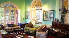 The main lounge at Ranjit's Svaasa, a 200-year-old heritage hotel in Amritsar, is decorated with antique pieces and art from the family's pe...