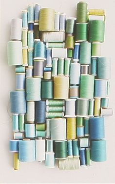 wall art for the craft room. Great way to use old thread!!!