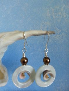 Mother of Pearl rings with curly shell accent earrings. Www.facebook.com/DesignsByHania