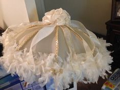New Orleans Flair Second Line Wedding Umbrella - great for weddings, parties, graduations, home decor, and many other reasons to celebrate in second line fashion.  A satin bow adorns the umbrella while feathers drapes the outline and gold and ivory trim adds the sparkle to collaborate with the gold and ivory bows dazzling within the feathers. This umbrella adds that final accessory touch for that special bride.