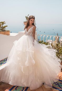la petra 2019 bridal sleeveless v neck heavily embellished bodice tiered skirt romantic ball gown a line wedding dress backless scoop back chapel train (9) mv -- La Petra 2019 Wedding Dresses | Wedding Inspirasi #wedding #weddings #bridal #weddingdress #bride ~