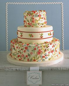 Hand-sculpted leaves, flowers, and fruits give this cake a look reminiscent of a vintage apron