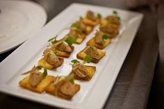"""Passed appetizers during the """"Rat Pack"""" charity dinner hosted by the senior class: Braised pork shank rillette on toast."""