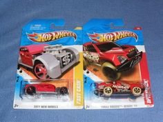 HOT WHEELS 1/64 Diecast . . . Lot of (2) . . . 2011 OFF TRACK RED NEELEY THRILL RACERS DESERT . . . 2011 FAST CASH RED by Hot Wheels. $0.95