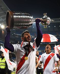 Ignacio Scocco of River Plate celebrates with the trophy after the. Carp, Madrid, Celebrities, Wattpad, Finals, Soccer, Amor, Celebs, Common Carp