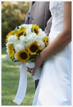 Google Image Result for http://www.flower-arrangement-advisor.com/images/sunflower_bridal_bouquet_4.jpg, maybe another possibility? Roses would make the bouquet look a little more elegant.