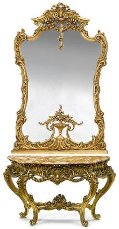 A Rococo style carved giltwood console and mirror 20th century