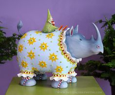 Jambo African Figure Roberta Rhino Figure would make a grand statement as a centerpiece at a baby shower!