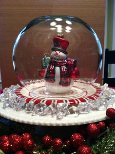 "I had the idea to use an inverted FISH BOWL to make a SNOW GLOBE :) Centerpiece. A friend had given me the little Peppermint-striped plate and I had the perfect snowman ornament to go inside plus the ""ICE""."
