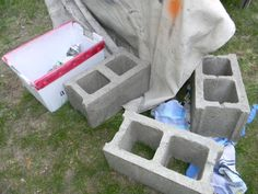 See how to stack a colorful row of cinder blocks to totally brighten up your garden—and get extra seating! I just completed this project on Saturday and it has added a great outdoor living space and really brightened up our front patio area. Cinder Block Bench, Cinder Blocks, Bench Block, Clematis, Ikea Storage Cubes, Crate Bench, Making A Bench, Building A Kitchen, Outdoor Side Table