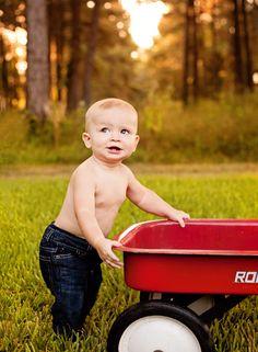 Our boy is almost one!!!  #lovelylightphotography #smashcake #one #birthday #photo #boy #dinosaur #wagon
