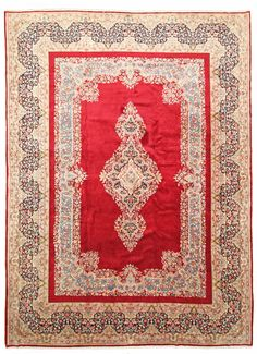 A spicy red in its center makes this oriental rug a real highlight. Hand-crafted in Kerman, an oasis in the desert near Teheran. It measures 300x409