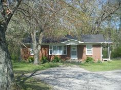 Wow! Take a look at this 3 bedroom brick, sitting on a beautiful lush shaded tract with a creek in your back yard in Lawrenceburg, TN.