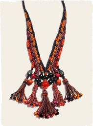 The unique, handcrocheted necklace brightens a look, in shimmery pima with colorful bead-tipped tassels.