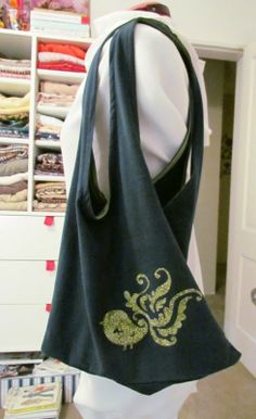 I've finally found a use for my daughter's old barbie shirt that I just couldn't get rid of. LOL!  DIY T-Shirt Tote Bag
