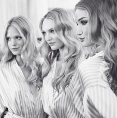Candice Swanepoel with Erin Heatherton and Rosie Huntington-Whiteley backstage at the 2009 Victoria's Secret Fashion Show