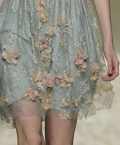 Pastel dress with sewn-on flowers