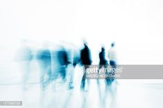 Stock Photo : Abstract Silhouettes of People Walking Against White Background