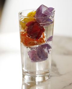 Super-sized ice cubes melt slower (dilute the drink less), and you can add organic flower petals for a pop of fun and color!!
