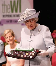 telegraph:  Queen Elizabeth presents the Centenary Women's Institute baton as the Countess of Wessex looks on at the Women's Institute centenary annual general meeting at Royal Albert Hall, June 4, 2015