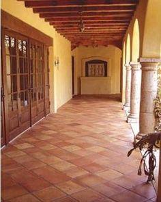 French doors/terra cotta tile/wood ceiling breezeway